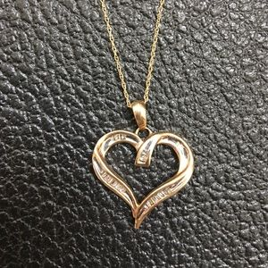Jewelry - Gold and diamond heart necklace